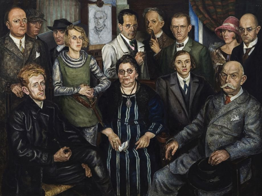Arthur Kaufmann - Die Zeitgenossen (Das Junge Rheinland), 1925. W dolnym rzędzie, od prawej siedzą / Bottom row, from the right, sitting: Gert Wollheim, Johanna Ey, Karl Schwesig, Adalbert Trillhaase.  W górnym rzędzie, od prawej stoją / Top row, from the right, standing: Herbert Eulenberg, Theo Champion, Jankel Adler, Hilde Schewior, Ernst te Peerdt (wizerunek na sztaludze / image on the easel), Arthur Kaufmann, Walter Ophey, Otto Dix, Lisbeth Kaufmann, Hans Heinrich Nicolini.
